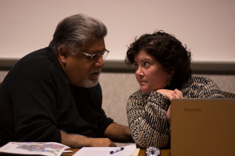 Lou Vasquez, board Chair and retired Toledo Police Sergeant, meets with board member Karin Coble.