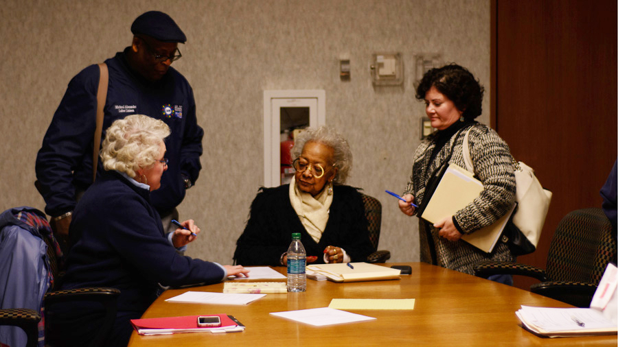 After attending a meeting, former Toledo City Council member Theresa Gabriel (center) discusses the issues with board members and other attendees. (Photo Credit: Crystal Jankowski)