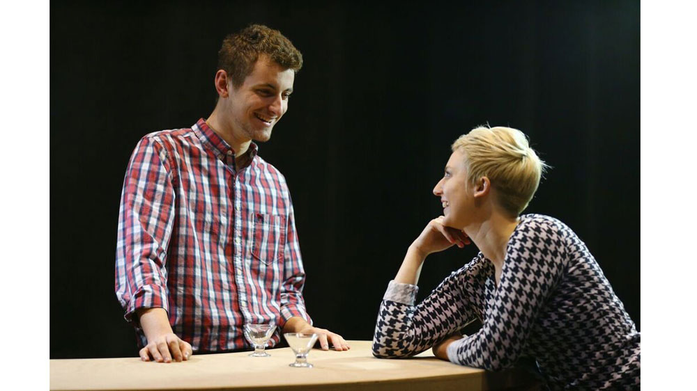 """Lowell"" (Carter Makiewicz) flirts with ""Sara"" (Tori Zajac) in a rehearsal scene. Photo Credit: Dan Miller"