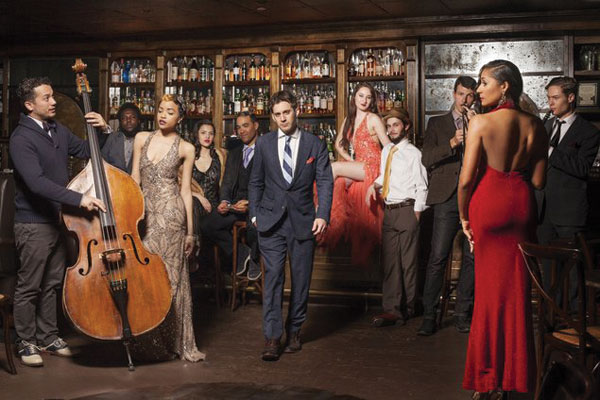 Scott Bradlee (center) is surrounded by members of his anachronistic hep-cat band, Postmodern Jukebox, coming to the Toledo Zoo Amphitheater July 14