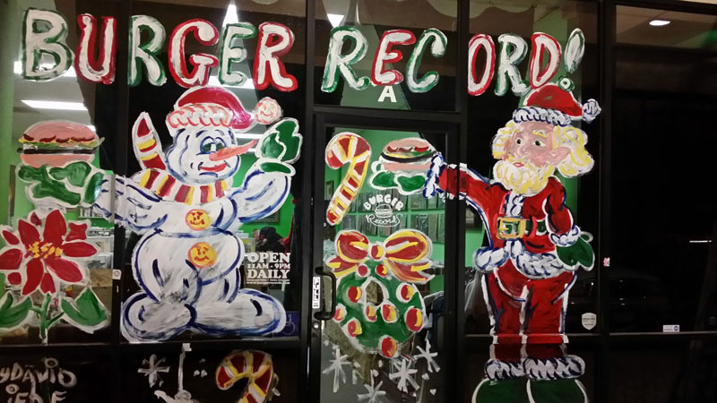 David Liebe Hart's custom window paintings in the storefront of Fullerton, CA's famous Burger Records.