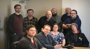 Front Row (L-R):  Maxwell Cuprys, David Kuznicki, Virginia Shine and Matt Erman. Back Row (L-R):  Michael DeSanto, Marty Nicholas, Jack O'Hare, M.J. Koleszar, Gary Drayton and Michael Austin.