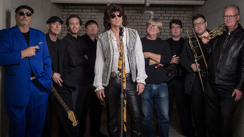 """Phil Barone and The Cruisers present a very special Jim Morrison tribute concert— Jim is """"Back from the Desert."""" (Pictured left to right) Mikey Blue Barone on harp, Pat McDonagh on lead guitar, Zane Babylon on keyboards, Andrew Struve on bass, Phil Barone as Jim, Pistol Pete Robinson on drums, Andrew Ewing on sax, Bob Huff on trombone, and Brad Sharp on the horn."""