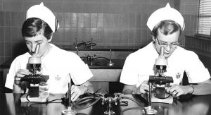 A pair of nursing students use microscopes in their microbiology lab in 1957. (Photo courtesy of Mercy College of Ohio archives)