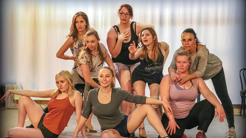(L-R) Erica Harmon, Christina Youngblood [back], Breah Duschl [middle], KC Lyphout [front], Tricia Kushen [center back], Katelyn Lesle [center, playing Charity], Brook Matthews [front], and Lydia Schafer [back].