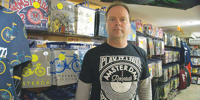 """Dr. Matt Donahue at one of the many different souvenir t-shirt shops in Amsterdam, during the filming of the """"Amsterdam T-Shirt Project."""""""