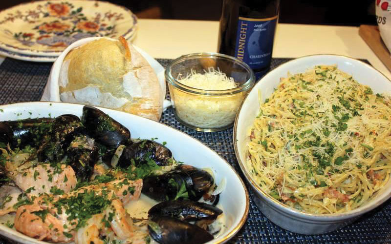 Mussels with salmon and shrimp with pasta carbonara.