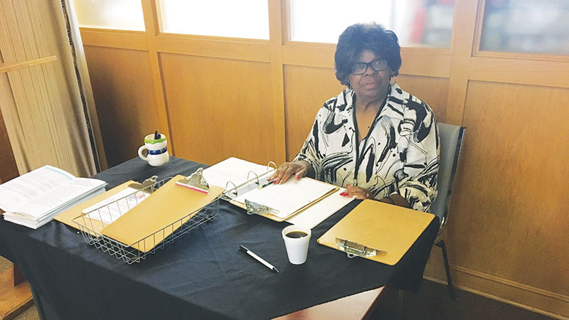 Eva Jennings, 71, volunteers every Tuesday by checking in people who come to seek assistance from The Bridge. She has been volunteering for four years and loves how positive of an impact the program is on the community.