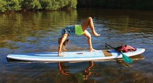 Health-Notes---Stand-Up-Paddleboard-Yoga-class