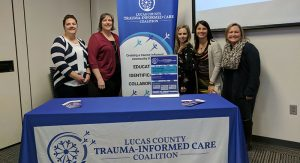 The LCTICC Advisory Board at the Three Year Celebration. (L-R) Diane Sweinhagen, LPCC-S (Cullen Center, ProMedica Toledo Children's Hospital), Jennifer Wolfe, LISW-S, Lucas County Board of Developmental Disabilities, Dr. Adrienne Elhai, Ph.D. Cullen Center, and Alicia Komives, LISW-S, Julie Pratt, LISW-S, Harbor.