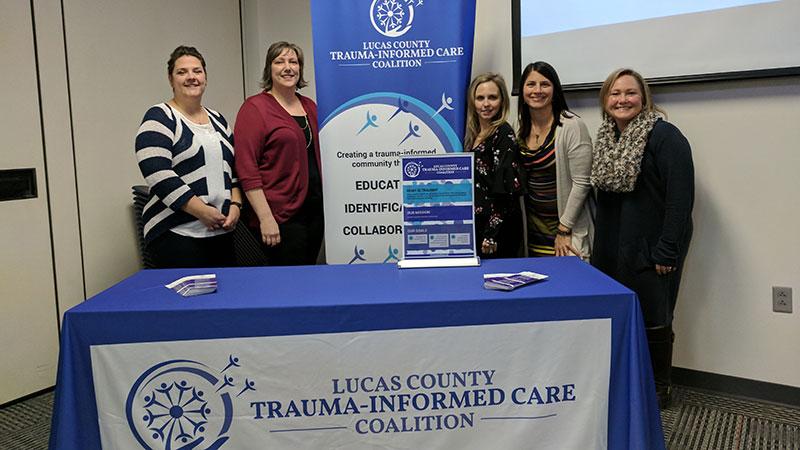 The LCTICC Advisory Board at the Three Year Celebration. (L-R) Diane Sweinhagen, LPCC-S (Cullen Center, ProMedica Toledo Children's Hospital), Jennifer Wolfe, LISW-S, Lucas County Board of Developmental Disabilities, Dr. Adrienne Elhai, Ph.D. Cullen Center, and Alicia Komives, LISW-S, Julie Pratt, LISW-S, Harbor.