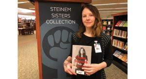 Rebecca Stanwick, TLCPL librarian, introduces one of over 400 new feminist book titles.