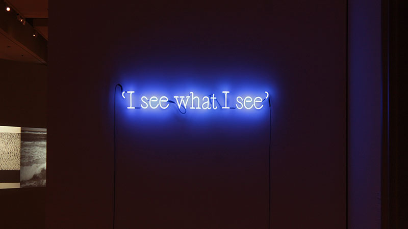 P.G. #9 (i see what i see), Joseph Kosuth (a Toledo native), 1991. TMA owns this work, and it welcomes gallery visitors as the first visible piece.