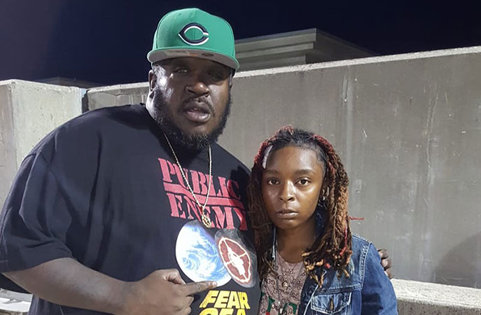 Bigg Eddie Bauer with artist Fortune; a female MC featured on one of Bauer's Mud Massacre videos which debuted Labor Day weekend.