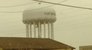 "The Flint water tower from the film ""Crossing Water – Flint Michigan – 2017""   Source: Holly Hey, 2018."