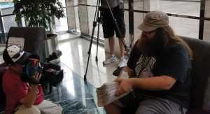 Bryan Twitchell, author of this article, turning in the petitions at Government Center.