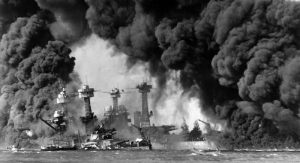 Burning ships at Pearl Harbor. Photo Credit: Wikimedia Commons.