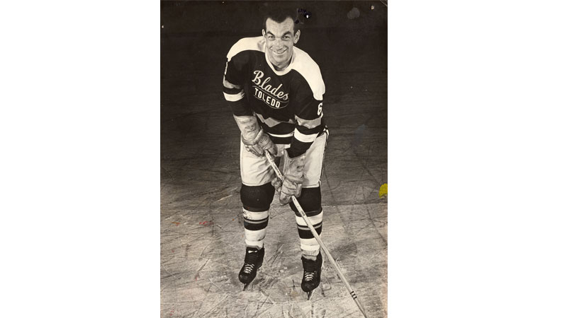 "Maurice ""Moe"" Benoit was a defenseman who played for and coached the Toledo Blades from 1963 through 1966. Prior to his tenure in the Glass City, Benoit played for several Canadian International teams and won a silver medal as part of the 1960 Canadian Olympic Team."