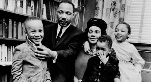 In this March 17, 1963, photo, Dr. Martin Luther King Jr. and his wife, Coretta Scott King, sit with three of their four kids. From left: Martin Luther King III, 5, Dexter Scott, 2, and Yolanda Denise, 7.  (THE ASSOCIATED PRESS)