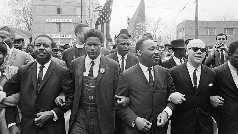Dr. Martin Luther King Jr. leads a march to the courthouse in Montgomery, Ala., on March 17, 1965.