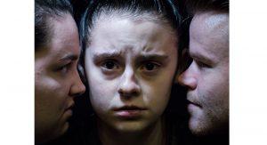 "Faith Murphy as ""Ariel,"" Grace Mulinix as ""Katurian,"" and Bryan Harkins as ""Tupolski"" in The Pillowman."