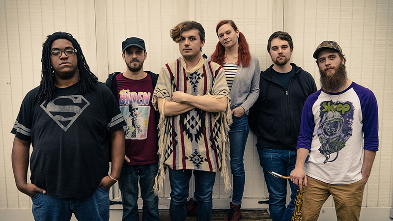Left to Right: Devonte Stovall (bass) Calvin Cordy (guitar), Dustin Galish (vocals, synth), Sarah Smith (keyboards), JP Stebal IV (drums), Garrett Tanner (saxophone). Photo by Conor Schall