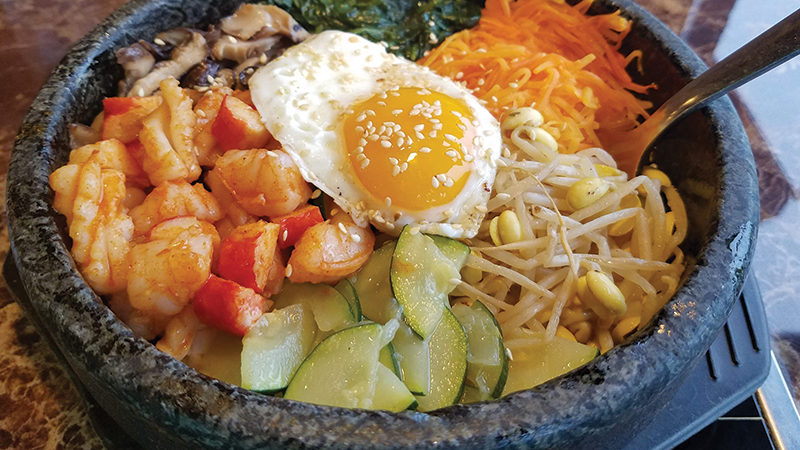 Chowline_-Hot-Pot---Seafood-Bibimbap-served-in-a-heated-stone-bowl