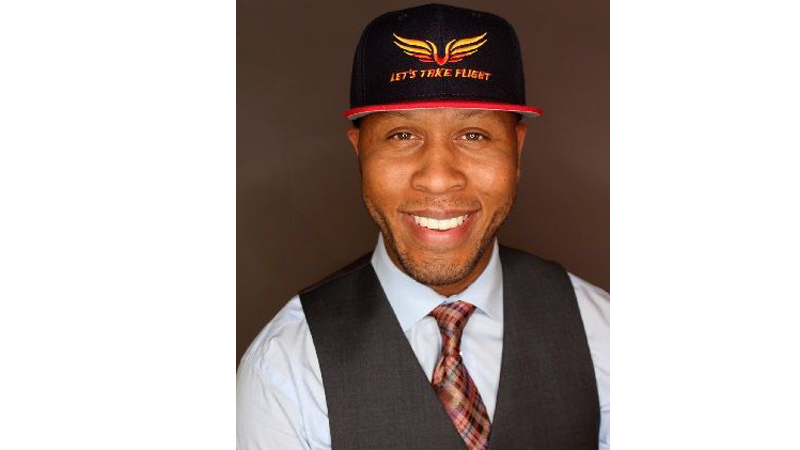 "Dr. Victor Coleman, creator of the VJ Coleman Flight School, donning his ""Let's Take Flight"" cap. You can purchase the cap and other apparel at letstakeflight.com. PHOTO CREDIT: Transitions by John Poon - Headshot - VJ Coleman Jr. Flight School"