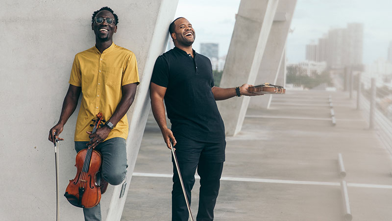 "(L-R) Wilner Baptiste and Kevin Sylvester, the classically-trained musicians whose YouTube video for ""A Flat"" has reached more than 10 million views, will perform at The Valentine Theatre on Wednesday, November 6. Photo Credit: Mark Clennon."