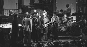The-Last-Waltz---The-Band,-with-Bob-Dylan-and-guests,-during-_I-Shall-Be-Released_.-Photo-courtesy-of-wikipedia.org-