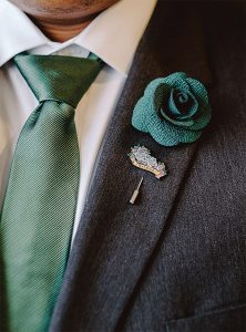 """Rather than wearing boutonnieres, our wedding party wore a single cloth flower and a unique enamel pin that was representative of our relationship with that person."""