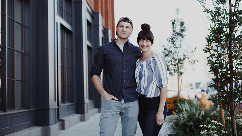 Chris and Cyndi Hileman: partners, co-founders of Hyggelight, The Growing Candle based out of Toledo, Ohio. Photo Credit: Kailah Jackson @bluegreenpatina.