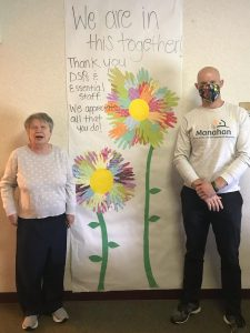 The staff at their residential facility helped the residents create a special thank you banner that included flowers that were made by tracing the residents' hands. The staff is doing a great job keeping residents busy with activities, taking care of their personal needs, encouraging them to get outside for walks, meals, and more.