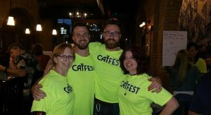 "(L-R) Karen Biller with Michael and Matt Lambert, the sons of Cathryn ""Cat"" Lambert, and Dee Brown, CAT FEST organizer. Photo courtesy: CAT FEST Facebook Page"