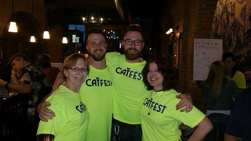 "(L-R) Karen Biller with Michael and Matt Lambert, the sons of Cathryn ""Cat"" Lambert, and Dee Brown, CAT FEST organizer. Photo courtesy: CAT FEST Facebook Page"