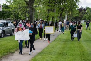 People continue the march up Franklin Avenue toward Adams Street. (Photo credit: Christy Frank)