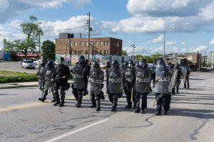 Toledo Police in riot gear proceed up 17th Street in downtown Toledo. (Photo credit: Christy Frank)