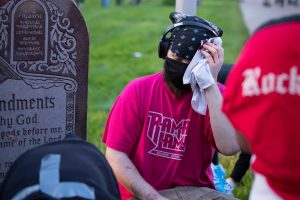 A protestor holds his bleeding head after Toledo Police fired a wood cylinder at him, causing injury. (Photo credit: Christy Frank)