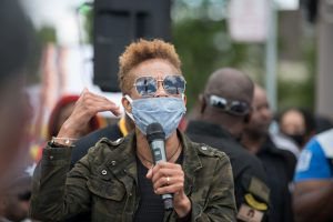Diana Patton speaks to the crowd at the Police Accountability March. (Photo credit: Christy Frank)