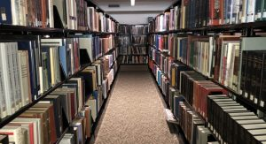Rows of books in library