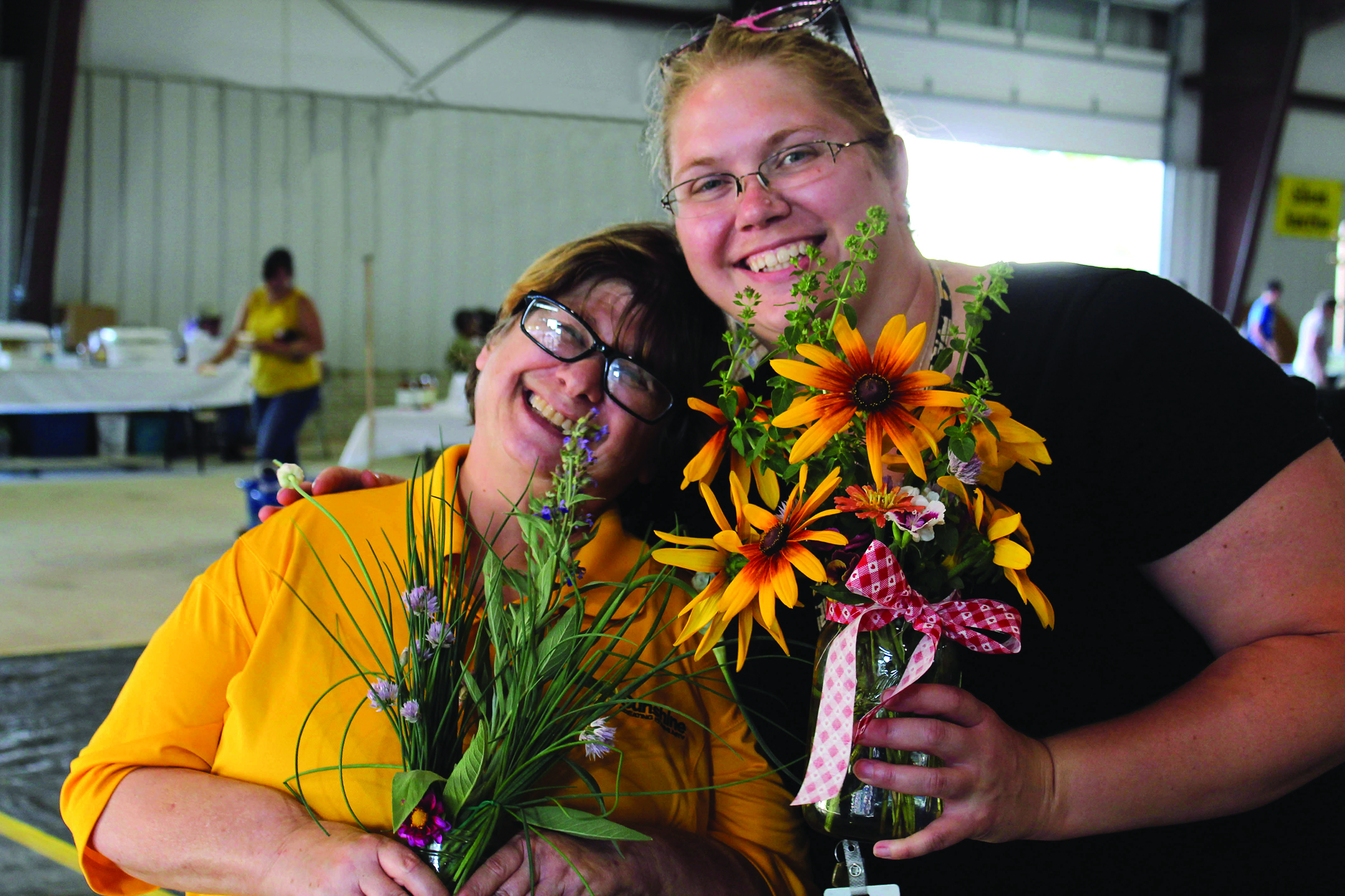 Sara Lewis (Right) who works with our greenhouse crew, and one of the members of the greenhouse crew Miss Lynn (Left)