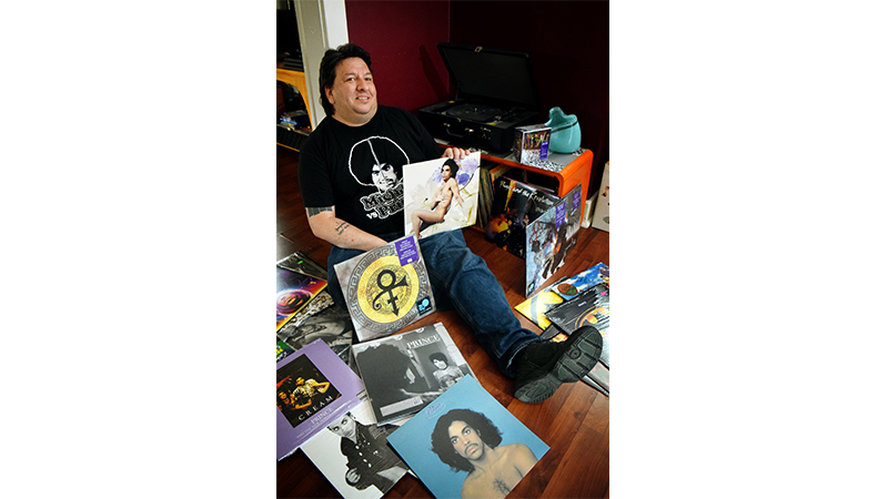 Author Jason Webber circled by his collection of Prince vinyl.