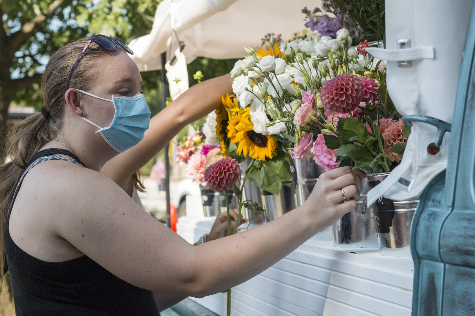 A customer brings friends to experience the joy of picking a personal bouquet at the Woodville Farmer's Market. Photo by Joni Johnson.